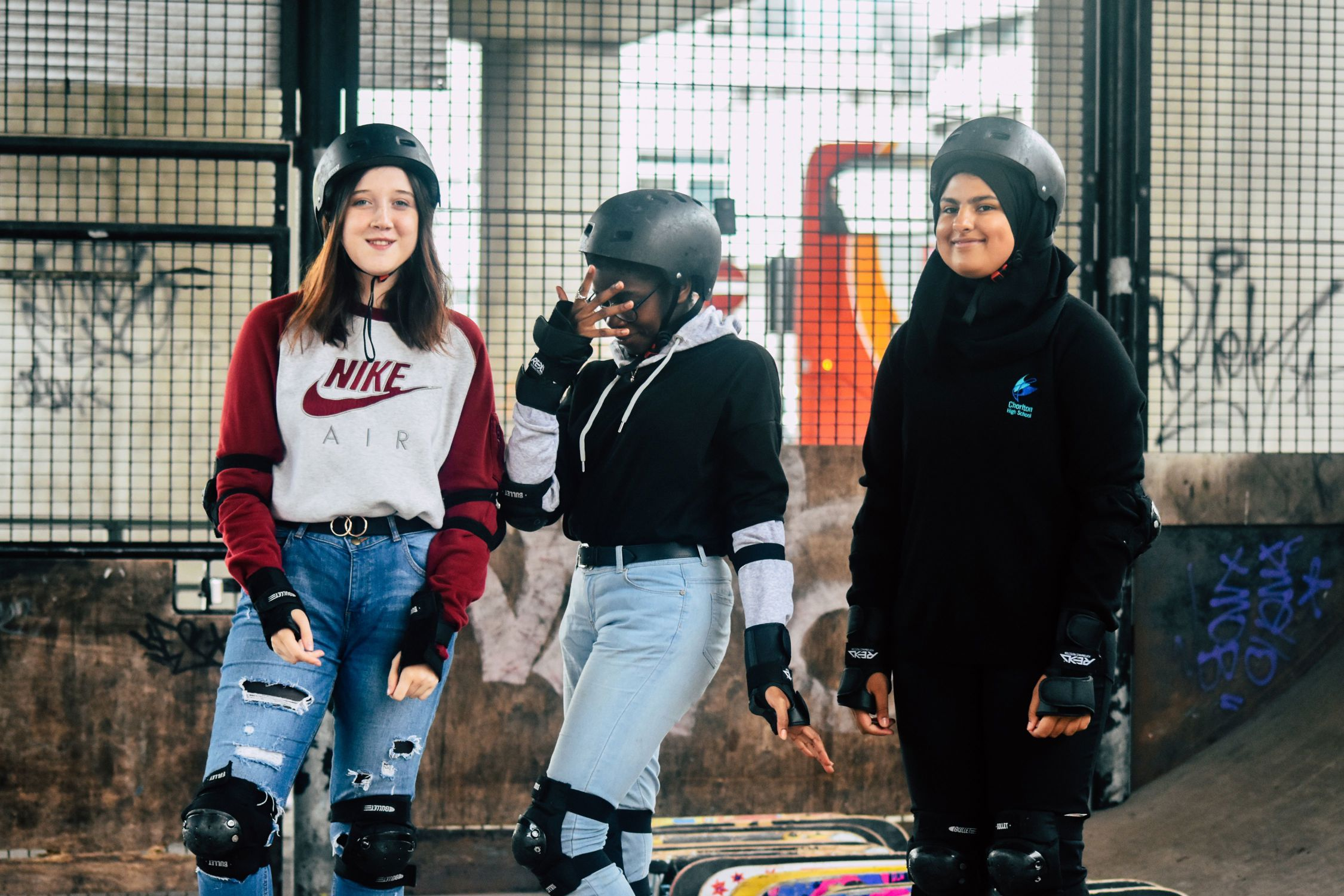 Young people together at skatepark