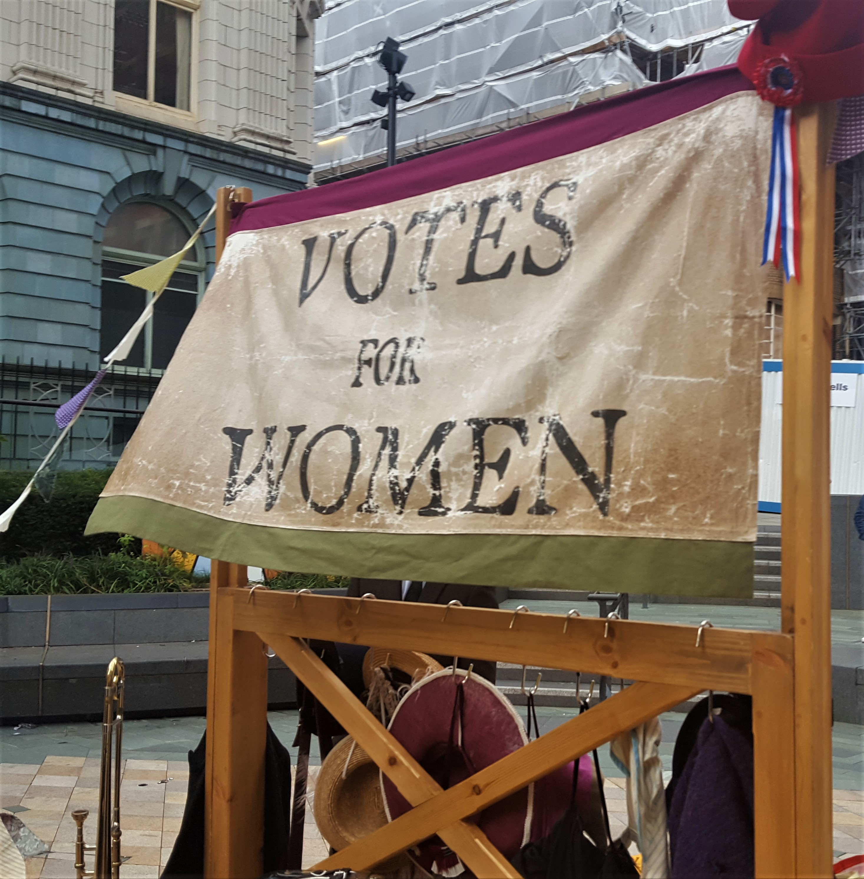 Banner behind the stage at Suffrage in the City
