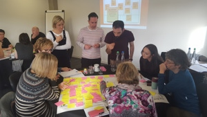 A group of people complete an activity during a workshop