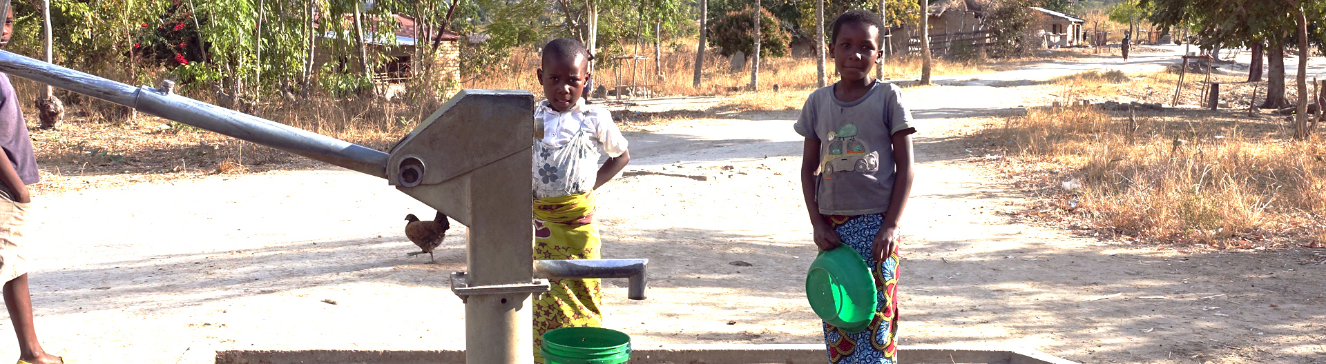Children with water pump in Malawi