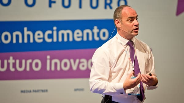 Simon speaking at conference