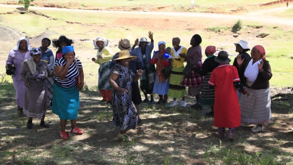 Happy people in Lesotho dancing and singing