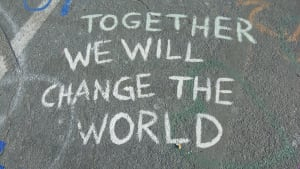 chalk writing that says Together we will change the world